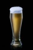 Öl Öl in i exponeringsglas på svart bakgrund Arkivbilder