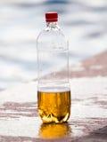 Öl i en plast- flaska Royaltyfri Foto