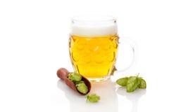 Öl med flygturfrukt Arkivbild