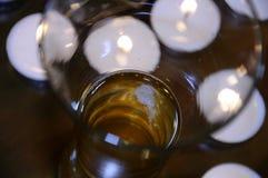 Öl med stearinljus arkivfoto