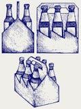 Öl sex packe i tre askar Arkivbild
