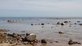 Öland costal view. Scattered rocks on the coast beach of Swedens island of Öland royalty free stock photography