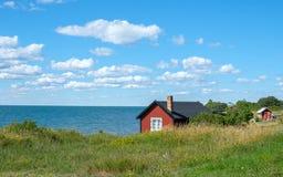 Öland, Sweden. Fishermans cottages at Djupvik on the west coast of Swedish Baltic sea island Öland. Öland is a popular tourist destination in Sweden royalty free stock image