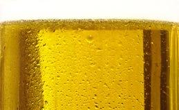 ölbubblor stänger upp exponeringsglas Arkivfoto