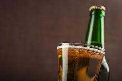 Ölexponeringsglas och buteljerar Arkivbilder