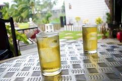 Ölexponeringsglas på tabellen Royaltyfria Bilder