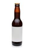 Ölflaska med den tomma etiketten Arkivfoto