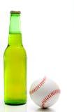 Ölflaska och baseball Royaltyfria Foton