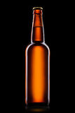 Ölflaska på svart Royaltyfri Bild