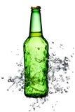 Ölflaskafärgstänk Arkivfoto