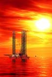 Ölplattform bei Sonnenaufgang stockfotografie