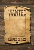 Önskad lös västra affisch på gammal träbakgrund fotografering för bildbyråer