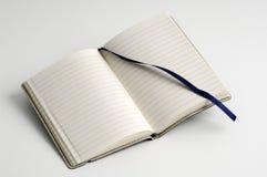 öppen anteckningsbok Arkivbilder