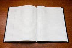 öppen anteckningsbok Royaltyfri Bild