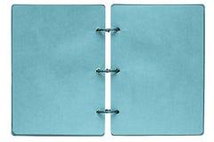 Öppen anteckningsbok med sidor av blåttfärg Royaltyfri Fotografi