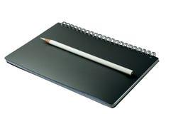 öppen blyertspenna för anteckningsbok Royaltyfri Fotografi