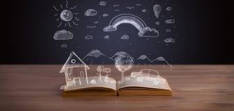 Öppen bok med hand dragit landskap Arkivbilder