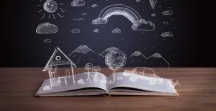 Öppen bok med hand dragit landskap arkivbild