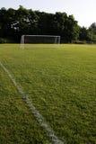 öppen fotboll för fält Arkivfoto
