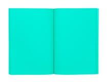 Öppen grön bok som isoleras på vit Arkivfoton
