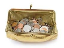 Öppen guld- metallisk mynthandväska som är över huvudet med skugga Arkivbilder