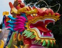 Öppen mun för färgrik drake Fotografering för Bildbyråer