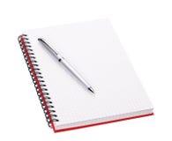 öppen penna för anteckningsbok Arkivfoton