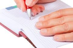 öppen penna för handanteckningsbok Royaltyfria Bilder