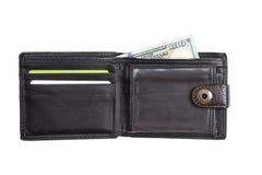 Öppen svart läderplånbok med kontanta dollar Royaltyfri Bild