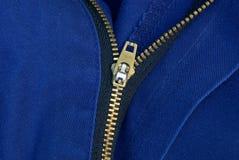 Öppen vinande för gul metall på blå kläder arkivfoton