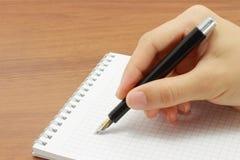 öppen writing för handanteckningsbok Arkivfoton