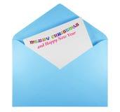 Öppet kuvert med glad jul för text - ljus - blått Arkivbild