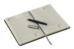 Öppna anteckningsboken och skriva arkivfoto