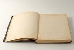 Öppna bakgrund för den gamla boken. Royaltyfria Foton