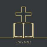 Öppna bibeln med ett kors Arkivfoto