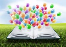 Öppna boken med ballonger Royaltyfria Foton