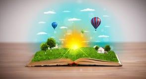 Öppna boken med den gröna naturvärlden som kommer ut ur dess sidor Royaltyfri Fotografi