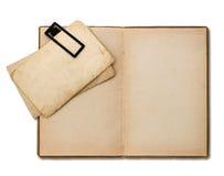 Öppna den gamla boken med pappers- ark arkivfoton