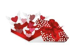 Öppna den röda asken för gåvan med avtågande hjärtor med vingar Valentin` s Arkivfoto