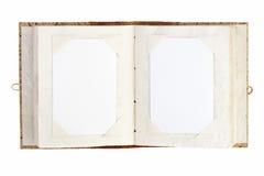 Öppna det gammala fotoalbum med förlägger för dina foto som isoleras på whit arkivbild