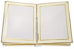 Öppna en tom vit bok och skriva Arkivbilder
