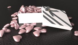 Öppna gåvaasken mycket av rosa hjärtor Royaltyfri Bild