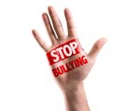 Öppna handen som lyfts med texten: Stoppa att trakassera som isoleras på vit bakgrund Arkivfoto