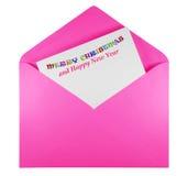 Öppna kuvertet med glad jul för text - rosa färger Arkivfoton