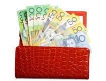 Öppna plånboken med pengar på isolerad white Royaltyfria Foton