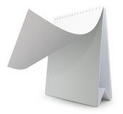 Öppna skrivbordkalendern som isoleras på vit Arkivfoton