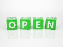 Öppna ut ur grön bokstav tärnar Royaltyfri Fotografi