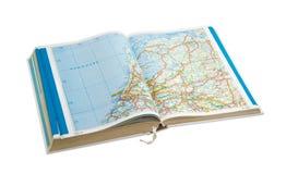Öppna vägkartboken på en ljus bakgrund Fotografering för Bildbyråer