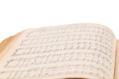 Öppnad bok för musikalisk sammansättning Arkivbild
