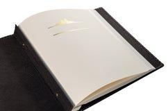 Öppnad bok med tomma sidor och dekorativ ram för text Royaltyfri Fotografi
